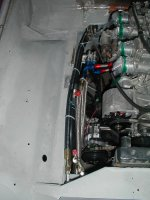 Did my own plumbing work. Must be very carefull not to scratch the fittings when tightening them up. If you look close you can see that I moved the oil filter to the frame rail and back toward the firewall to give me better access from below the car.